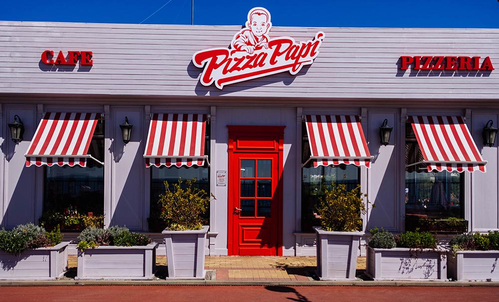 Pizza Papi storefront signs in Santa Ana, CA
