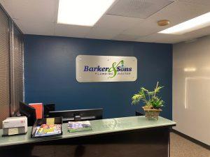 Barker Sons front desk reception signs
