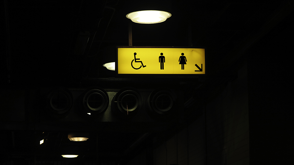Yellow and black directional signs